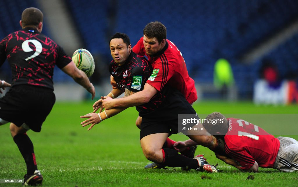 Edinburgh player Ben Atiga releases the ball despite the attentions of the Munster defence during the Heineken Cup Round 5 match between Edinburgh and Munster at Murrayfield Stadium on January 13, 2013 in Edinburgh, Scotland.