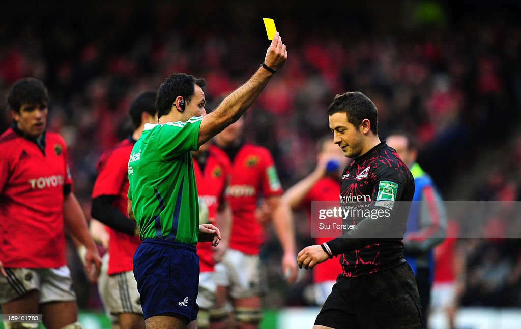 Edinburgh player <a gi-track='captionPersonalityLinkClicked' href=/galleries/search?phrase=Greig+Laidlaw&family=editorial&specificpeople=5072404 ng-click='$event.stopPropagation()'>Greig Laidlaw</a> is yellow carded by referee Romaine Poite during the Heineken Cup Round 5 match between Edinburgh and Munster at Murrayfield Stadium on January 13, 2013 in Edinburgh, Scotland.