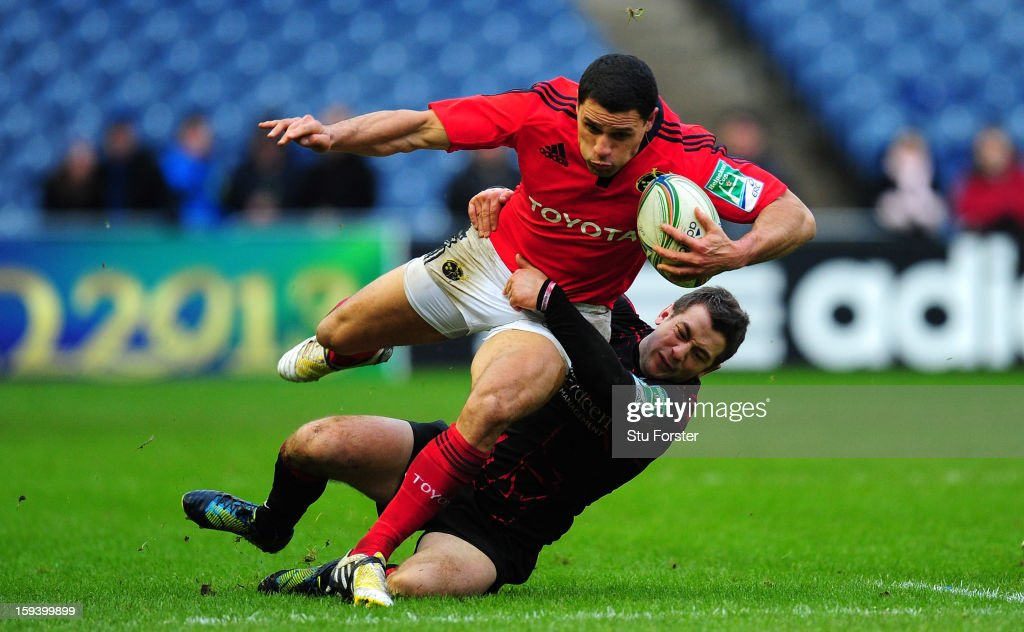 Edinburgh player <a gi-track='captionPersonalityLinkClicked' href=/galleries/search?phrase=Greig+Laidlaw&family=editorial&specificpeople=5072404 ng-click='$event.stopPropagation()'>Greig Laidlaw</a> tackles Munster wing <a gi-track='captionPersonalityLinkClicked' href=/galleries/search?phrase=Doug+Howlett&family=editorial&specificpeople=563491 ng-click='$event.stopPropagation()'>Doug Howlett</a> during the Heineken Cup Round 5 match between Edinburgh and Munster at Murrayfield Stadium on January 13, 2013 in Edinburgh, Scotland.