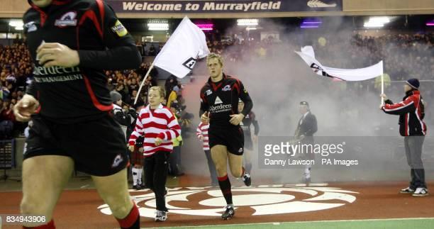 Edinburgh players take to the field prior to kick off