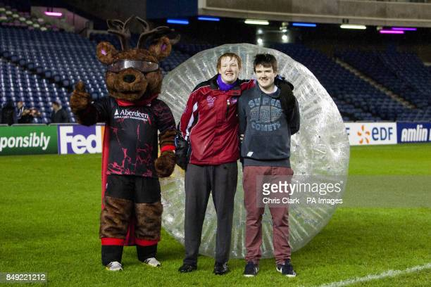 Edinburgh Rugby fans take part in some Zorbing on the pitch
