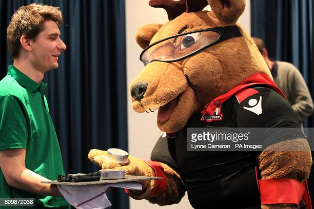 Edinburgh Rugby mascot Flinty McStag enjoys a free pie in the Thistle Bar before kick off