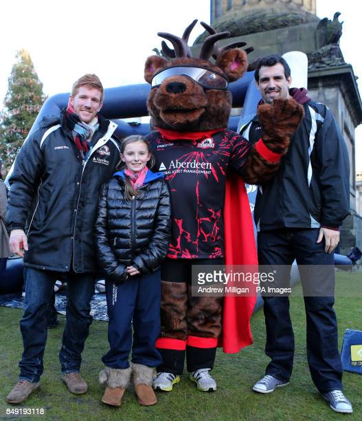 Edinburgh Rugby players Roddy Grant and Sean Cox with eleven year old Hope Riley from Edinburgh as they encourage members of the public to try their...