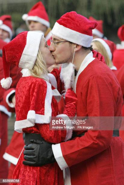Edinburgh Students Anthony Rocheforst from France kisses Amy Walters as they take part in the Great Scottish Santa Run in Princes Street Gardens in...