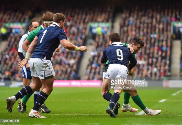 Edinburgh United Kingdom 4 February 2017 Conor Murray of Ireland is tackled by Greig Laidlaw of Scotland during the RBS Six Nations Rugby...