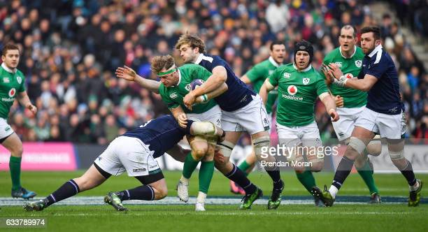 Edinburgh United Kingdom 4 February 2017 Jamie Heaslip of Ireland is tackled by Zander Fagerson left and Richie Gray of Scotland during the RBS Six...