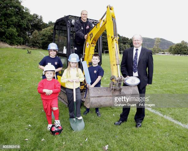 Edinburgh winger Andrew Turnbull and Lismopre RFC's Malcolm Gillies with children from Lismore RFC Edinburgh South FC and Edinburgh Cricket Club...