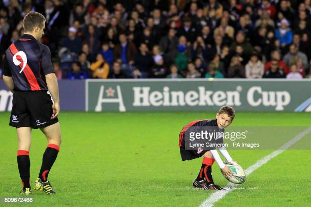Edinburgh's Greig Laidlaw looks on as the matchday mascot places the matchball on the centre spot