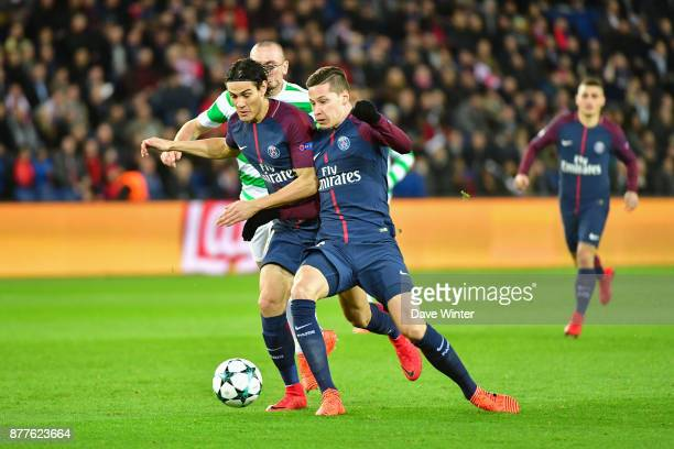 Edinson Cavani and Julian Draxler of PSG battle over the same ball during the UEFA Champions League match between Paris Saint Germain and Glasgow...