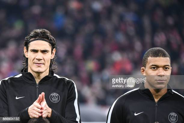 Edinson Cavani and Kylian Mbappe of PSG during the UEFA Champions League match between Bayern Munich and Paris Saint Germain at Allianz Arena on...