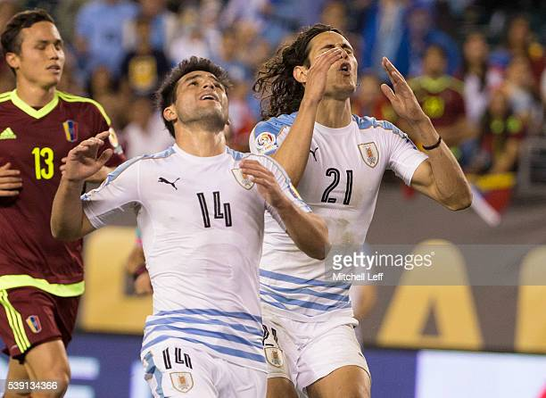 Edinson Cavani and Nicolas Lodeiro of Uruguay react after a shot went wide against Venezuela during the 2016 Copa America Centenario Group C match at...