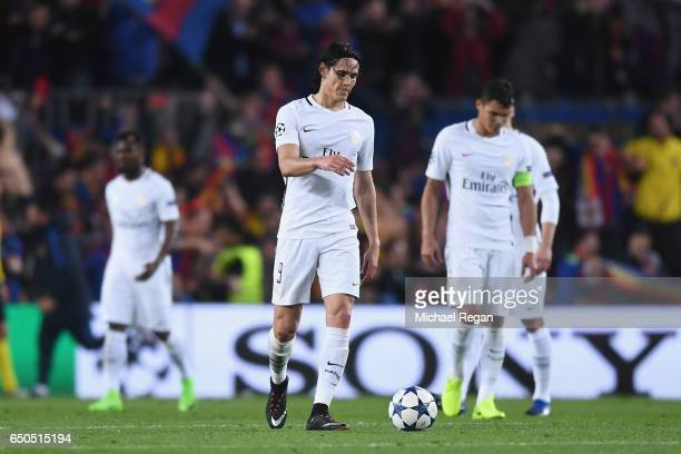 Edinson Cavani and Thiago Silva of PSG look dejected after Barcelona's 6th goal during the UEFA Champions League Round of 16 second leg match between...