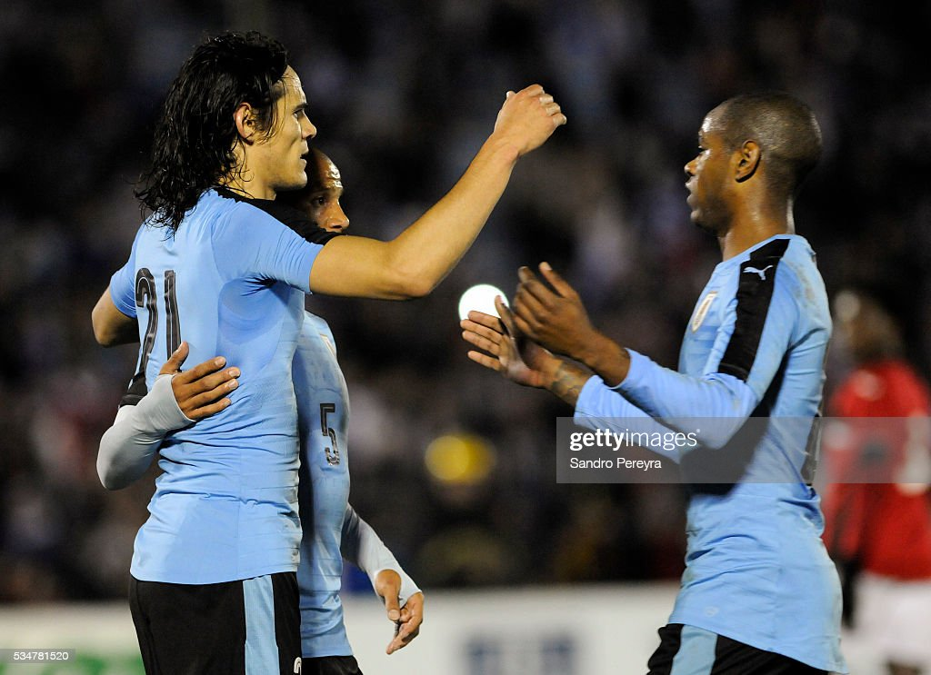 <a gi-track='captionPersonalityLinkClicked' href=/galleries/search?phrase=Edinson+Cavani&family=editorial&specificpeople=4104253 ng-click='$event.stopPropagation()'>Edinson Cavani</a>, Carlos Sanchez and Diego Rolan celebrate their team's first goal during an international friendly match between Uruguay and Trinidad & Tobago at Centenario Stadium on May 27, 2016 in Montevideo, Uruguay.
