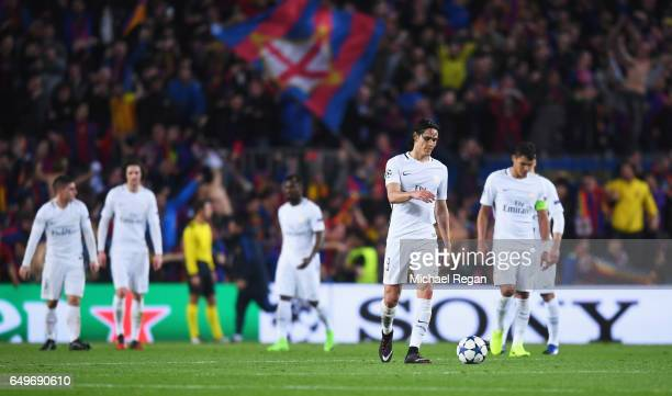 Edinson Cavani of Edinson Cavani of PSG and team mates look dejected as Sergi Roberto of Barcelona scores their sixth goal during the UEFA Champions...