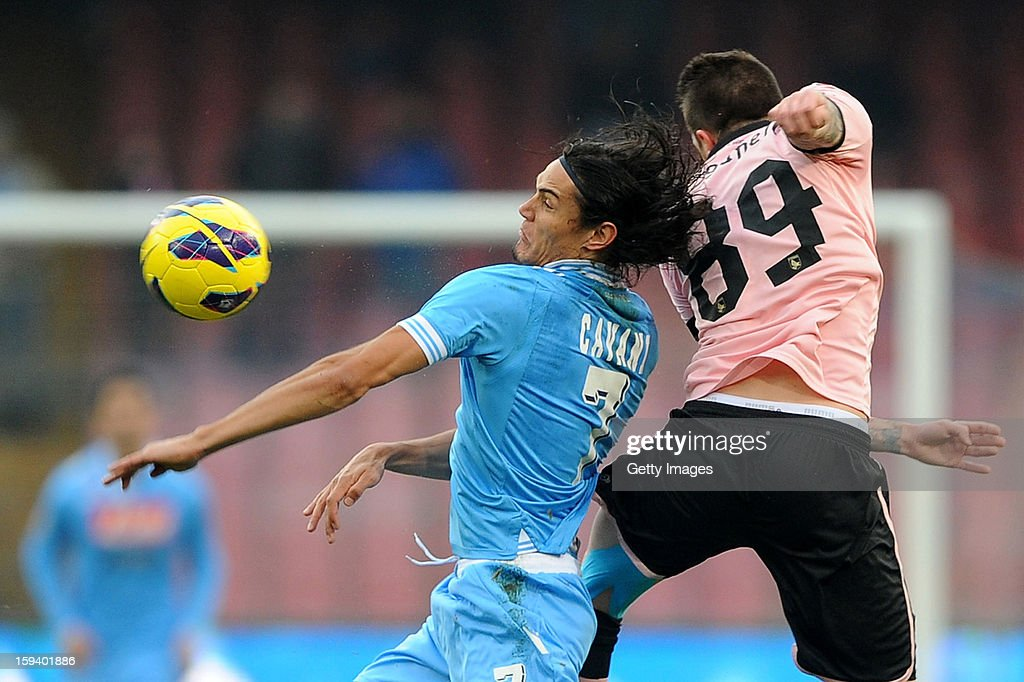 <a gi-track='captionPersonalityLinkClicked' href=/galleries/search?phrase=Edinson+Cavani&family=editorial&specificpeople=4104253 ng-click='$event.stopPropagation()'>Edinson Cavani</a> (L) of Napoli go up with Michael Morganella of Palermo during the Serie A match between SSC Napoli and US Citta di Palermo at Stadio San Paolo on January 13, 2013 in Naples, Italy.