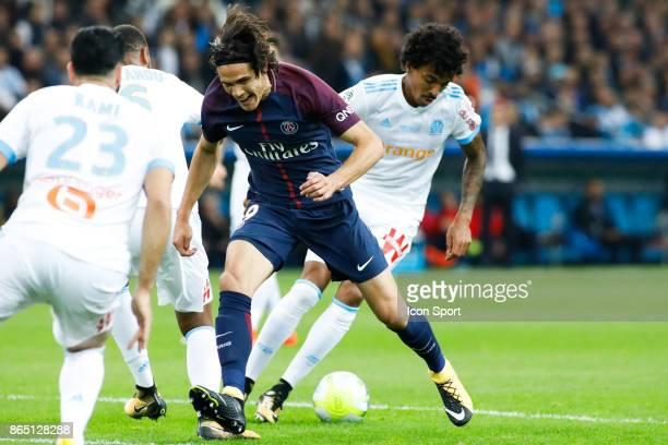 Edinson Cavani of Paris and Luiz Gustavo of Marseille during the Ligue 1 match between Olympique Marseille and Paris Saint Germain at Stade Velodrome...