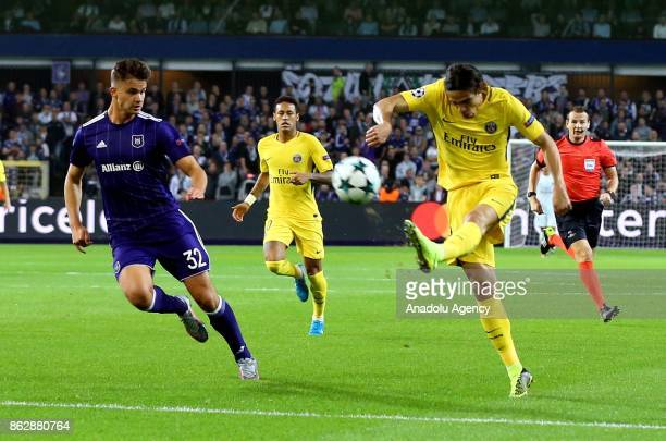 Edinson Cavani of Paris Saint Germain in action against Leander Dendoncker of Anderlect during the UEFA Champions League Group B match between...