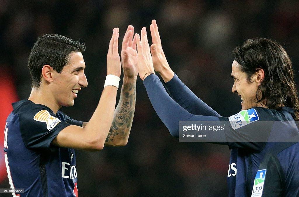 Edinson Cavani of Paris Saint-Germain celebrate his goal with Angel Di Maria (L) during the French League Cup between Paris Saint-Germain and AS Saint Etienne at Parc Des Princes on december 16, 2015 in Paris, France.