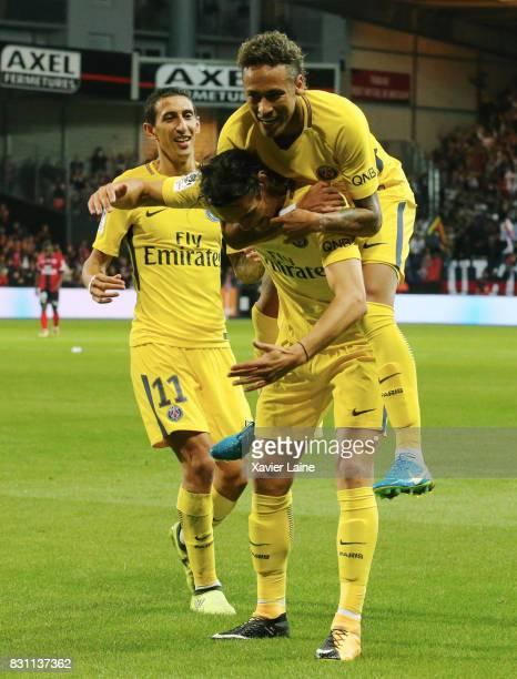 Edinson Cavani of Paris SaintGermain celebrate his goal with Neymar Jr and Angel Di Maria during the French Ligue 1 match between EA Guingamp and...