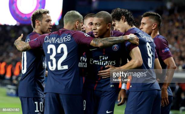 Edinson Cavani of Paris SaintGermain celebrate his goal with Neymar Jr and Kylian Mbappe during the UEFA Champions League group B match between Paris...