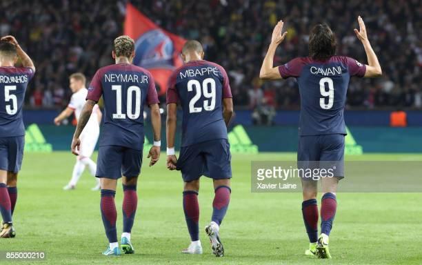 Edinson Cavani of Paris SaintGermain celebrate his goal with Neymar Jr and Kylian Mbappe during the UEFA Champions League group B match between Paris...