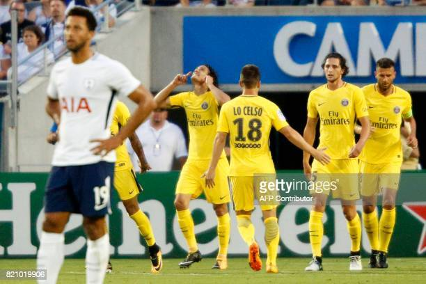 Edinson Cavani of Paris SaintGermain celebrates after scoriag a goal against Tottenham Hotspur during their international friendly match on July 22...