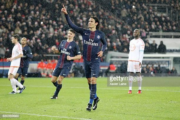 Edinson Cavani of Paris SaintGermain celebrates his goal during the French Ligue 1 match between Paris SaintGermain and FC Lorient at Parc des...