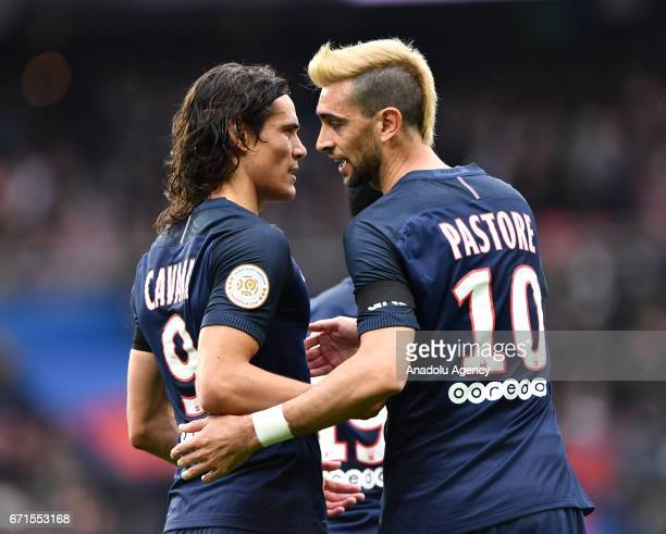 Edinson Cavani of Paris SaintGermain celebrates with Javier Pastore after scoring a goal during the French Ligue 1 football match between Paris...