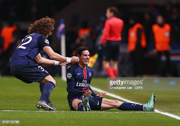 Edinson Cavani of Paris SaintGermain celebrates with team mate David Luiz as he scores their second goal during the UEFA Champions League round of 16...
