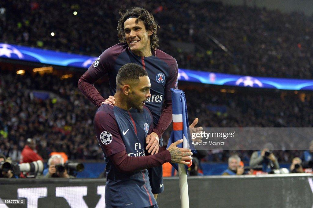 Edinson Cavani of Paris Saint-Germain congratulates his teammate Layvin Kurzawa after he scored a hat trick during the UEFA Champions League group B match between Paris Saint-Germain and RSC Anderlecht at Parc des Princes on October 31, 2017 in Paris, France.