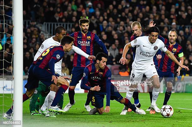 Edinson Cavani of Paris SaintGermain FC competes for the ball with FC Barcelona players during the UEFA Champions League group F match between FC...
