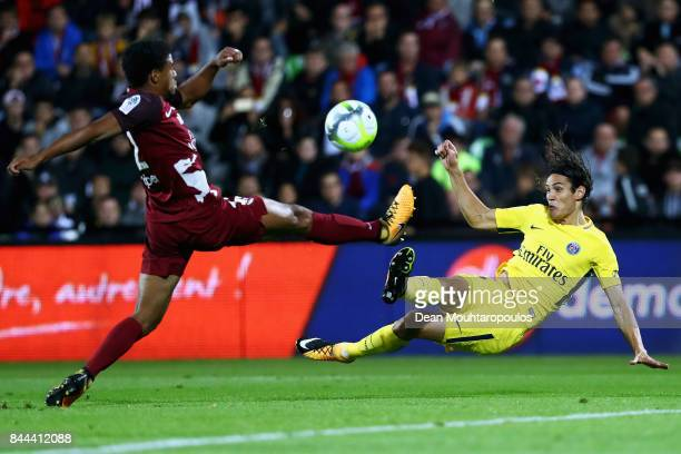 Edinson Cavani of Paris SaintGermain Football Club or PSG shoots on goal in front of Matthieu Udol of Metz FC during the Ligue 1 match between Metz...