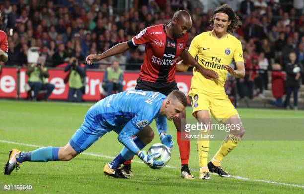 Edinson Cavani of Paris SaintGermain in action with KariJohan Johnsson of EA Guingamp during the French Ligue 1 match between EA Guingamp and Paris...
