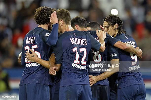 Edinson Cavani of Paris SaintGermain is congratulated by teammates for his goal during the Ligue 1 match between Paris SaintGermain and Dijon FCO at...