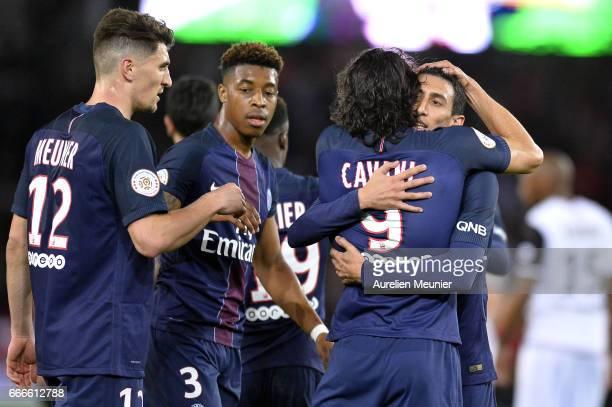 Edinson Cavani of Paris SaintGermain is congratulated by teammates Angel Di Maria Thomas Meunier and Presnel Kimpembe after scoring during the Ligue...