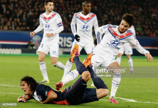 Edinson Cavani of Paris SaintGermain is tackle by Clement Grenier of Olypique Lyonnais during the French Ligue 1 between Paris SaintGermain FC and...
