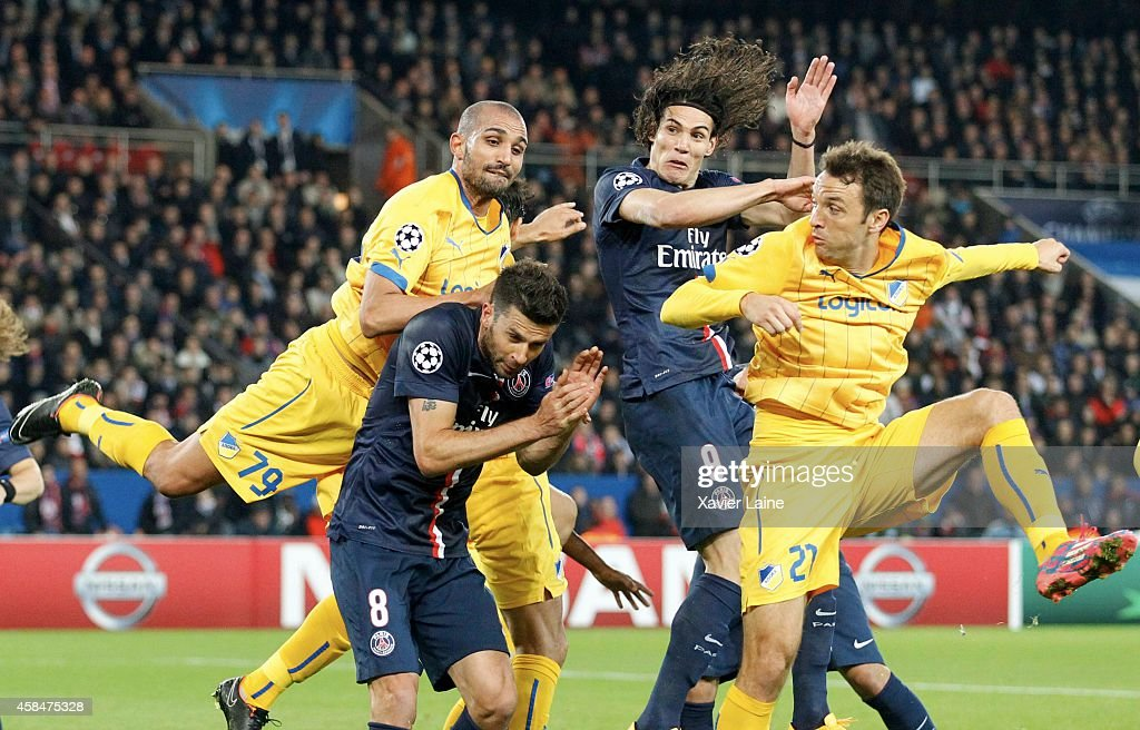 <a gi-track='captionPersonalityLinkClicked' href=/galleries/search?phrase=Edinson+Cavani&family=editorial&specificpeople=4104253 ng-click='$event.stopPropagation()'>Edinson Cavani</a> #09 of Paris Saint-Germain jump over <a gi-track='captionPersonalityLinkClicked' href=/galleries/search?phrase=Thiago+Motta+-+Brazilian+Soccer+Player+-+Born+1982&family=editorial&specificpeople=631059 ng-click='$event.stopPropagation()'>Thiago Motta</a> #08, <a gi-track='captionPersonalityLinkClicked' href=/galleries/search?phrase=Rafik+Djebbour&family=editorial&specificpeople=4509033 ng-click='$event.stopPropagation()'>Rafik Djebbour</a> #79 and Gustavo Manduca #21 of APOEL Nicosie during the UEFA Champions League Group F between Paris Saint-Germain and APOEL Nicosie at Parc Des Princes on November 05, 2014 in Paris, France.