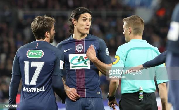 Edinson Cavani of Paris SaintGermain react with the referee during the French Cup SemiFinal match between Paris SaintGermain and As Monaco at Parc...
