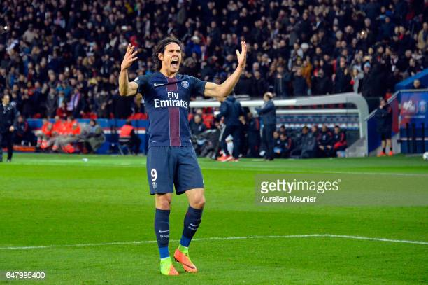 Edinson Cavani of Paris SaintGermain reacts after scoring during the French Ligue 1 match between Paris Saint Germain and Nancy at Parc des Princes...