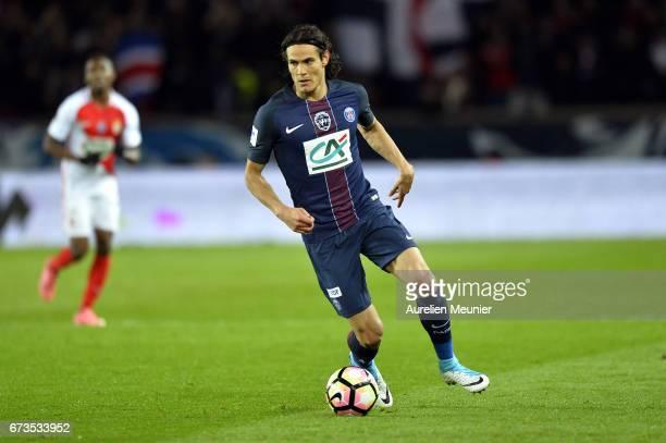 Edinson Cavani of Paris SaintGermain runs with the ball during the French Cup SemiFinal match between Paris SaintGermain and As Monaco at Parc des...
