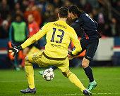 Edinson Cavani of Paris SaintGermain shoots past Thibaut Courtois of Chelsea to score their second goal during the UEFA Champions League round of 16...