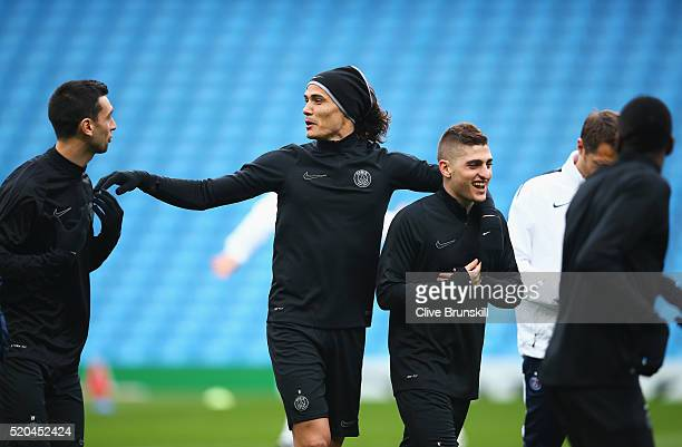 Edinson Cavani of Paris SaintGermain talks with Javier Pastore and Marco Verratti during a training session ahead of the UEFA Champions League...