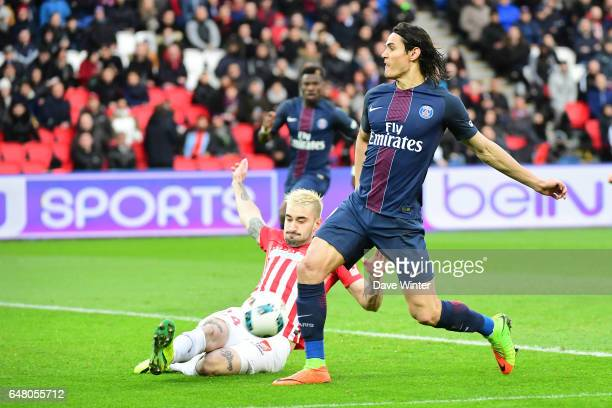 Edinson Cavani of PSG and Erick Cabaco of Nancy during the French Ligue 1 match between Paris Saint Germain and Nancy at Parc des Princes on March 4...