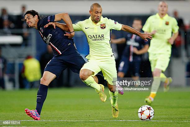 Edinson Cavani of PSG and Javier Mascherano of Barcelona battle for the ball during the Group F UEFA Champions League match between Paris...