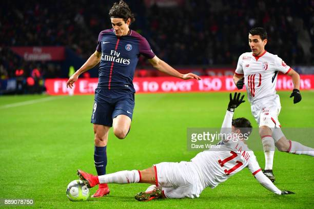Edinson Cavani of PSG and Luiz Araujo of Lille during the Ligue 1 match between Paris Saint Germain and Lille OSC at Parc des Princes on December 9...