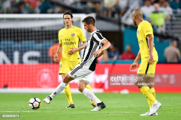 Edinson Cavani of PSG and Rodrigo Bentancur of Juventus in action during the International Champions Cup 2017 match between Paris Saint Germain and...