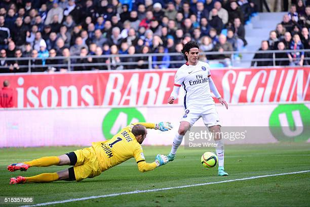 Edinson Cavani of PSG beats Matthieu Dreyer of Troyes to put his side 10 up during the French Ligue 1 match between ESTAC Troyes and Paris...