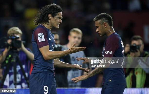 Edinson Cavani of PSG celebrates his first goal with Neymar Jr during the French Ligue 1 match between Paris Saint Germain and AS SaintEtienne at...