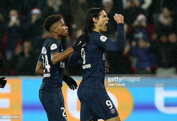 Edinson Cavani of PSG celebrates his goal on a penalty kick with Christopher Nkunku during the French Ligue 1 match between Paris SaintGermain and FC...