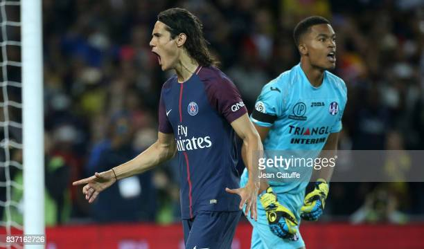Edinson Cavani of PSG celebrates his goal while goalkeeper of Toulouse Alban Lafont looks on during the French Ligue 1 match between Paris Saint...